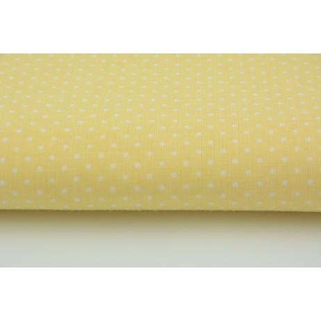 Bawełna 100% kropki białe 2mm na bananowym tle