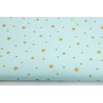 Cotton 100% gold stars on a light turquoise background