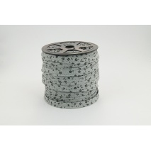 Cotton edging ribbon, black meadow on a gray background