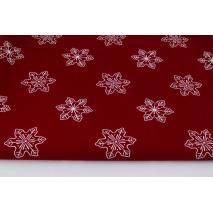 Cotton 100% large snowflakes on a bordeaux background