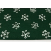 Cotton 100% large snowflakes on a dark green background