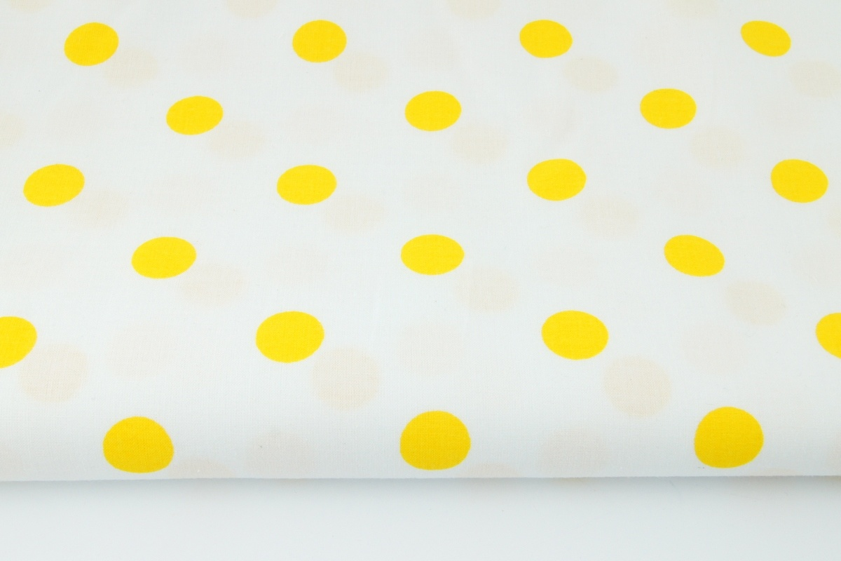 cotton 100 yellow polka dots 17mm on a white background