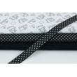 Cotton bias binding white dots on a black background