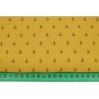Double gauze 100% cotton, small black anchors on a mustard background