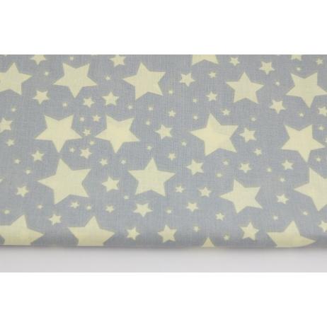 Bawełna 100% jasnożółte gwiazdki na jasnoszarym tle.