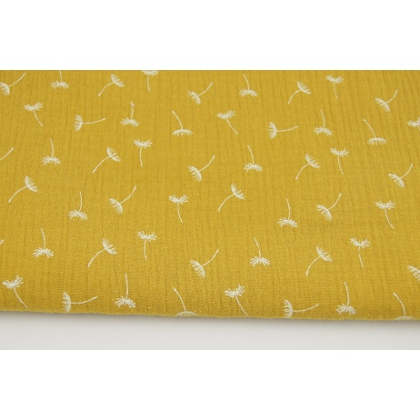Double gauze 100% cotton small puffballs on a mustard background