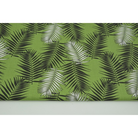 Cotton 100% black and white palm leaves on a green background