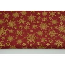 Bawełna 100% złote płatki śniegu na ciemnoczerwonym tle