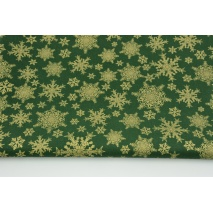 Cotton 100% gold snowflakes on a dark green background
