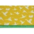 Bawełna 100% ptaszki origami białe na musztardowym tle