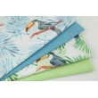 Cotton 100% toucans, blue palm leaves on a white background