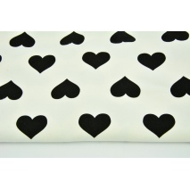 Looped knitwear black hearts on a cream background
