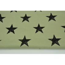 Dzianina, dresówka pętelkowa w czarne gwiazdy na oliwkowej zieleni