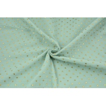 Double gauze 100% cotton golden stars on a powder mint background