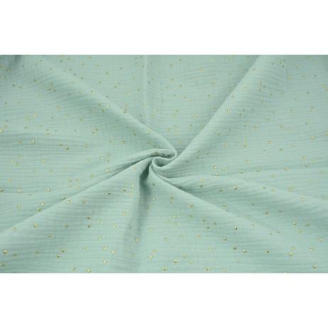 Double gauze 100% cotton golden dots on a powder mint background