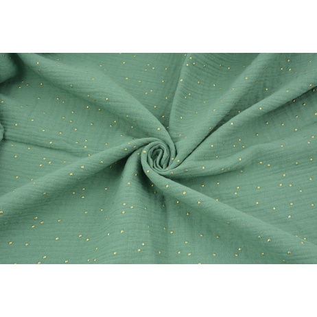 Double gauze 100% cotton golden dots on a green background