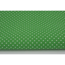 Cotton 100% white 2mm polka dots on a dark green background