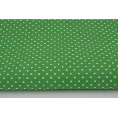 Cotton 100% white 2mm polka dots on a dark green background