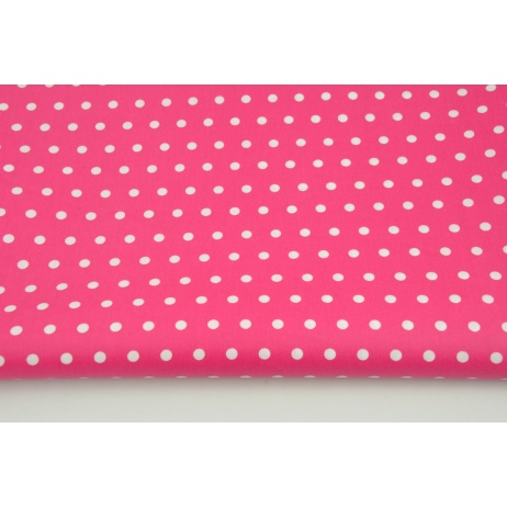 Cotton laminated 7mm dots on a fuchsia background