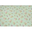 Tkanina dekoracyjna, średnie różowe kwiaty na miętowym tle 190 g/m2