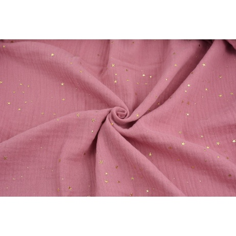 Double gauze 100% cotton golden mini stars on a lipstick pink background.