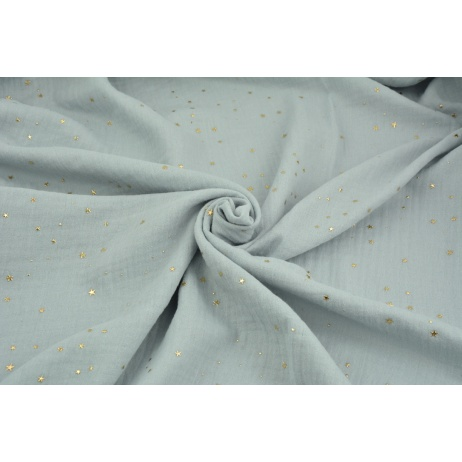 Double gauze 100% cotton golden mini stars on a light gray background