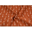 Double gauze 100% cotton giraffes on a ginger background