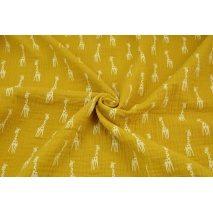 Double gauze 100% cotton giraffes on a mustard background