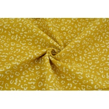 Double gauze 100% cotton white speckles on a mustard background