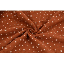 Double gauze 100% cotton irregular white stars on a ginger background