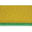 Double gauze 100% cotton irregular white stars on a mustard background