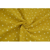 Double gauze 100% cotton irregular white stars on a mustard background