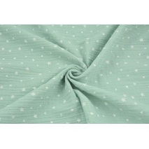 Double gauze 100% cotton irregular white stars on a powder mint background