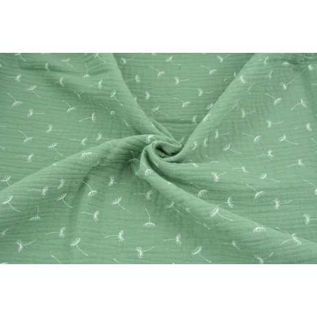 Double gauze 100% cotton small puffballs on a green background