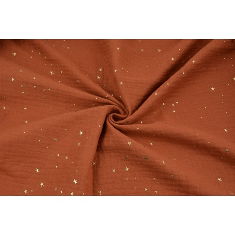 Double gauze 100% cotton golden mini stars on a ginger background