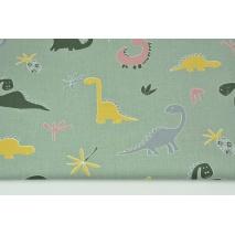 Bawełna 100% dinozaury na szałwiowym tle