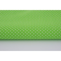 Cotton 100% white 2mm polka dots on a bright green background
