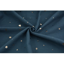 Double gauze 100% cotton golden irregular spots on a dark jeans background