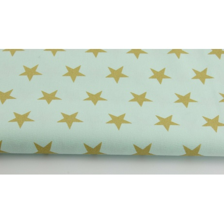 Cotton 100% gold stars 25mm on mint background.