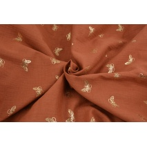 Double gauze 100% cotton golden butterflies on a ginger background