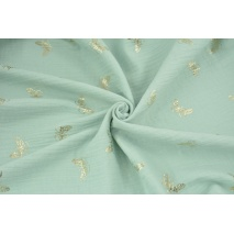Double gauze 100% cotton golden butterflies on a powder mint background