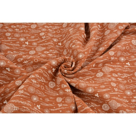 Double gauze 100% cotton botanical pattern on a ginger background