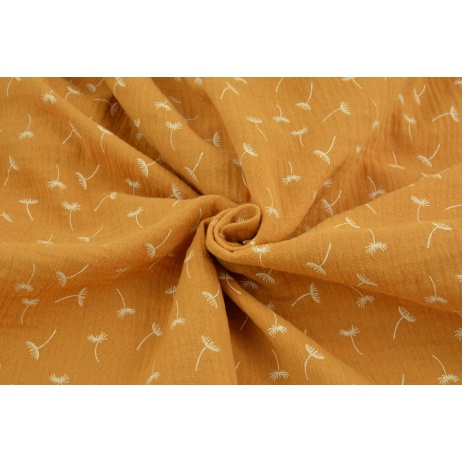 Double gauze 100% cotton small puffballs on a dark honey background