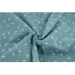 Double gauze 100% cotton small puffballs on a subdued blue background
