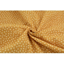Double gauze 100% cotton white polka dots on a dark honey background