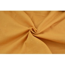 Double gauze 100% cotton gold dust on a dark honey background