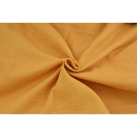 Double gauze 100% cotton gold dust on a dark honey background