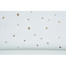 Double gauze 100% cotton golden irregular spots on a white background