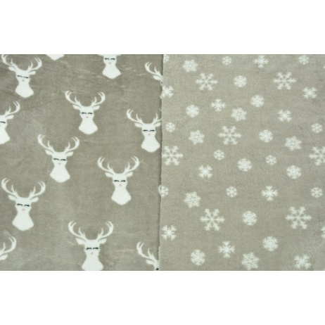 Double sided fleece, reindeers, snowflakes on a beige background