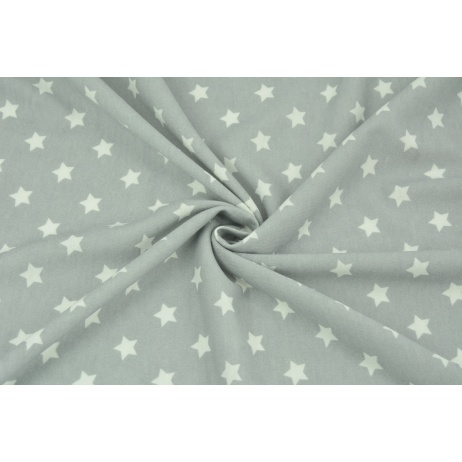 Knitwear viscose cream stars on a gray background